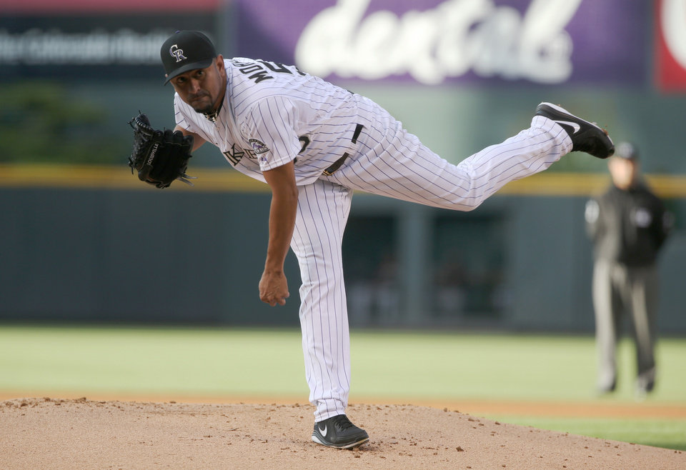 Photo - Colorado Rockies starting pitcher Franklin Morales works against the San Francisco Giants in the first inning of a baseball game in Denver on Tuesday, May 20, 2014. (AP Photo/David Zalubowski)