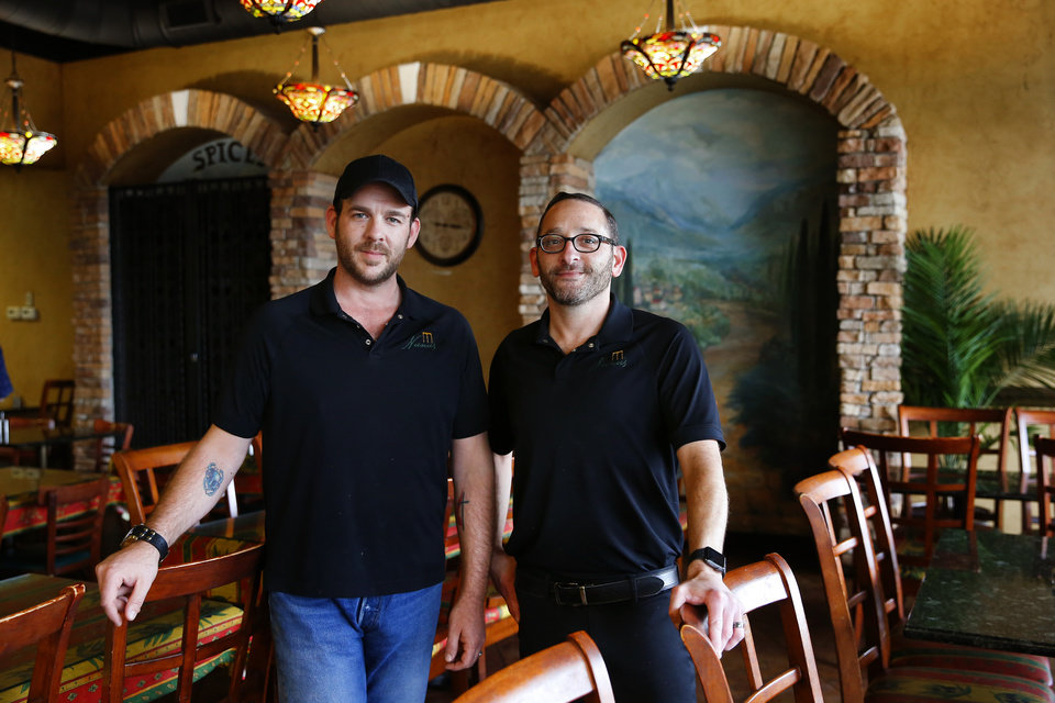 Photo -  Nunu's Mediterranean Cafe owner's Stephen Bradley, left, and Clayton Farhood are celebrating their restaurant's 10th anniversary this month. [Photo by Bryan Terry, The Oklahoman]