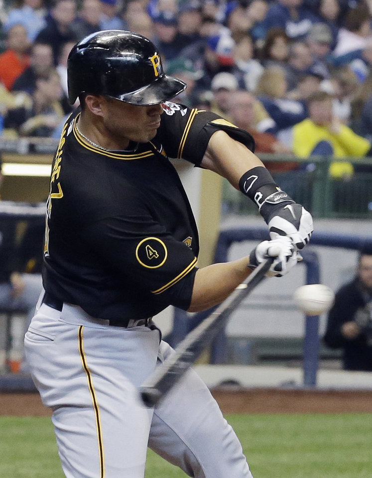 Photo - Pittsburgh Pirates' Tony Sanchez hits a two-run home run during the fifth inning of a baseball game against the Milwaukee Brewers Thursday, May 15, 2014, in Milwaukee. (AP Photo/Morry Gash)