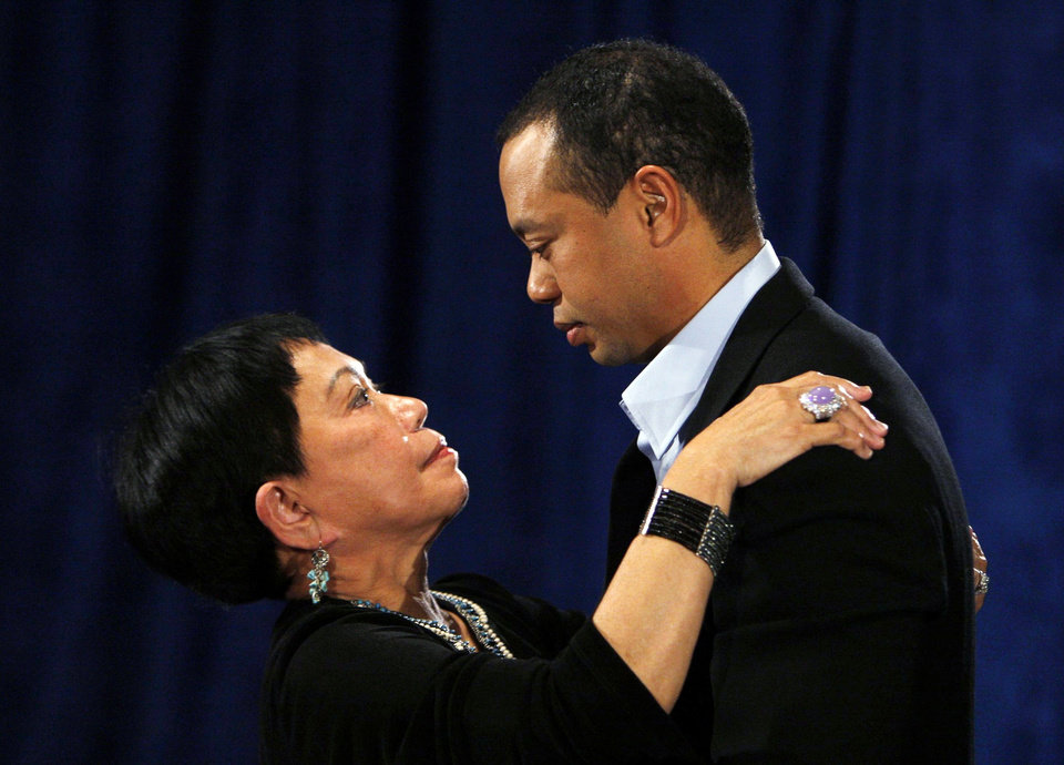 Photo - Tiger Woods talks to his mother Kultida Woods after making  a statement at the Sawgrass Players Club, Friday, Feb. 19, 2010, in Ponte Vedra Beach, Fla. (AP Photo/Joe Skipper, Pool) ORG XMIT: TWP102