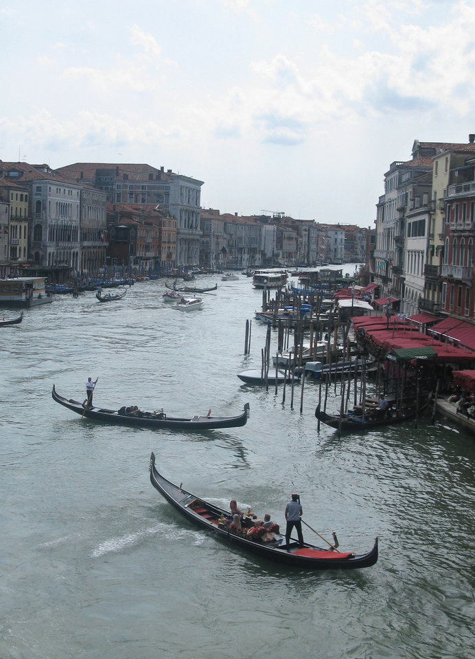 Photo - This July 15, 2012 photo shows Gondolas jockeying for position on the Grande Canale in the heart of Venice, Italy. To travel through northern Italy with a copy of Mark Twain's 1869 ''The Innocents Abroad', his classic 'record of a pleasure trip'. It took him to the great sights of Europe and on to Constantinople and Jerusalem before he sailed home to New York. Such a trip would take far too big a chunk out of my holiday time. But, Milan, Florence and Venice, a mere fragment for Twain, was within my reach for a two-week vacation. (AP Photo/Raf Casert)