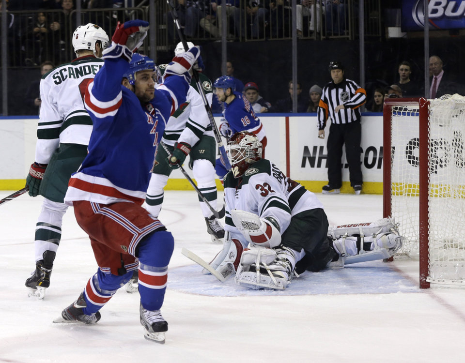 Photo - Minnesota Wild goalie Niklas Backstrom (32) reacts after being scored on by New York Rangers' Mats Zuccarello, left, during the second period of an NHL hockey game, Sunday, Dec. 22, 2013, in New York. (AP Photo/Seth Wenig)