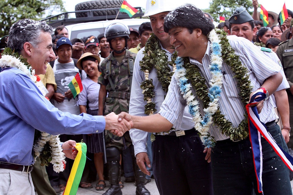 FILE - In this Dec. 14, 2006 file photo provided by the Bolivia's Presidential Press Office, Bolivia's President Evo Morales, right, shakes hands with U.S. ambassador Philip Goldberg during the inauguration of part of a road sponsored by the U.S. Agency for International Development (USAID) in the tropical region of El Sillar, Cochabamba, Bolivia. Morales said Wednesday, May 1, 2013 he is expelling the USAID from Bolivia for allegedly seeking to undermine his leftist government. (AP Photo/Noah Friedman Rudovsky, Bolivian Presidency, File)