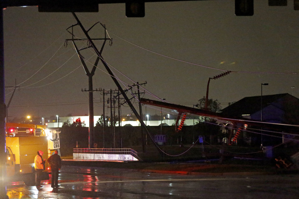 Photo - Power lines block Penn. Ave. just north of Memorial in Oklahoma City after a storm moved through the area on Saturday, May 18, 2013. Photo by Bryan Terry, The Oklahoman