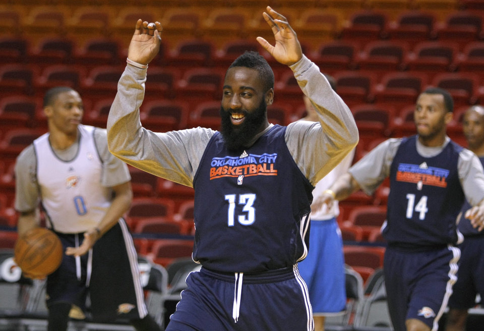 Photo - Oklahoma City's James Harden laughs as he stretches before practice for Game 3 of the NBA Finals between the Oklahoma City Thunder and the Miami Heat at American Airlines Arena in Miami, Saturday, June 16, 2012. Photo by Bryan Terry, The Oklahoman