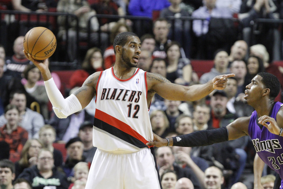 Photo - Portland Trail Blazers forward LaMarcus Aldridge, left, points to other players as Sacramento Kings forward Jason Thompson defends during the first quarter of their NBA basketball game in Portland, Ore., Saturday, Dec. 8, 2012.(AP Photo/Don Ryan)