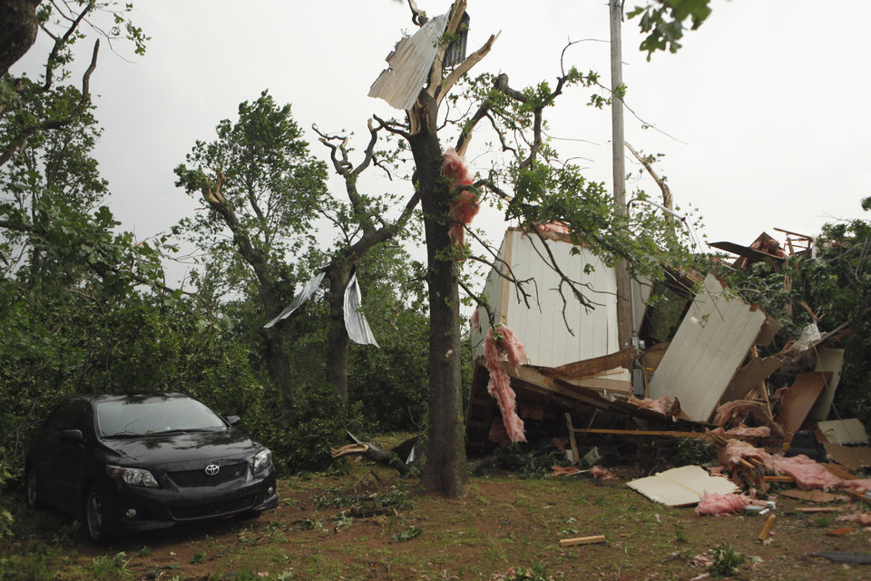 Photo - Little remains of a home on SE 84th south of Lindsay Street after a storm moved through the area on Monday, May 10, 2010, in Norman, Okla.  Photo by Steve Sisney, The Oklahoman