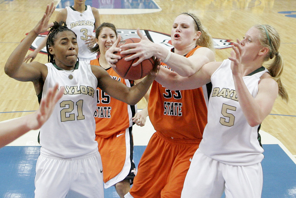 Photo - OSU's Megan Byford tries to grab a rebound between Baylor's Kelli Griffin, left, and Melissa Jones during the Big 12 Women's Championship game between Oklahoma State and Baylor at the Cox Center in Oklahoma City, Friday, March 13, 2009.  OSU lost to Baylor 67-62. PHOTO BY BRYAN TERRY, THE OKLAHOMAN