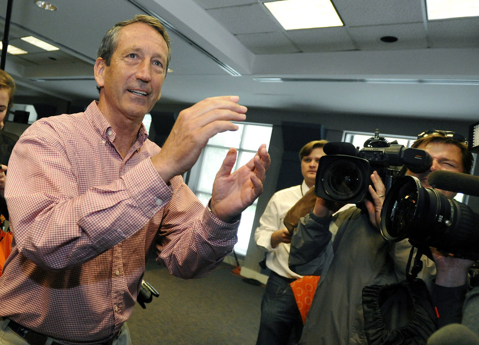 Photo - Former South Carolina Gov. Mark Sanford gestures after voting at a polling place in Charleston, S.C., Tuesday, May 7, 2013.  Sanford, a Republican, and Elizabeth Colbert Busch, a Democrat and sister of political satirist Stephen Colbert, are to face off for the 1st Congressional District seat, that was vacated when Tim Scott was appointed to the U.S. Senate. Green Party candidate Eugene Platt also is on the ballot.  (AP Photo/Rainier Ehrhardt)