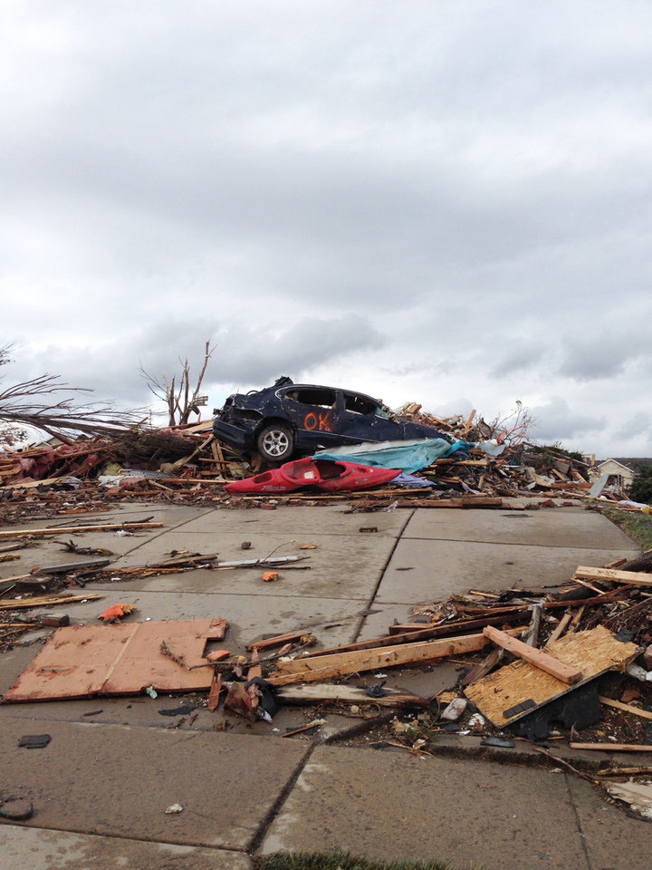 Photo - A view of part of Washington, Ill. is seen Sunday, Nov. 17, 2013 after a tornado moved through the area. Intense thunderstorms and tornadoes swept across the Midwest on Sunday, causing extensive damage in several central Illinois communities while sending people to their basements for shelter and even prompting officials at Soldier Field in Chicago to evacuate the stands and delay the Bears game.  (AP Photo/Alex Kareotes)