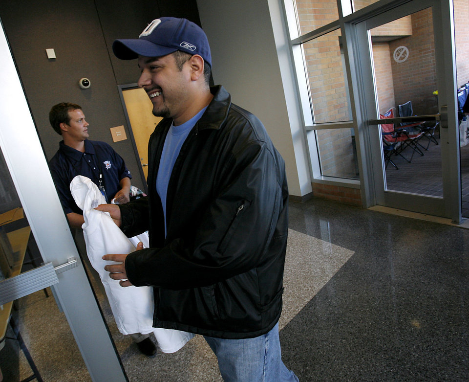 After waiting in line for several hours, Jesus Mena, of Oklahoma City, is the first to be let in to buy tickets at the first Oklahoma Cty Thunder game at Ford Center in downtown Oklahoma City on Wednesday, October 29, 2008. By John Clanton, The Oklahoman  ORG XMIT: KOD