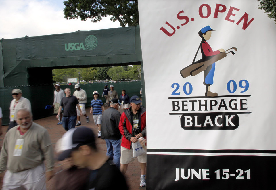 Photo - FILE - In this June 16, 2009, file photo, spectators arrive at the Bethpage State Park's Black Course to watch a practice round for the U.S. Open Golf Championship in Farmingdale, N.Y. The PGA of America announced Tuesday, Sept. 17, 2013, that course will host the 2019 PGA Championship and 2024 Ryder Cup. (AP Photo/Morry Gash, File)