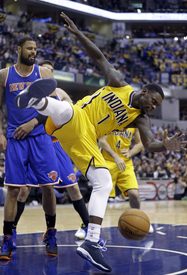 Photo - Indiana Pacers guard Lance Stephenson (1) comes down after being fouled by New York Knicks center Tyson Chandler on a shot during the second half of an NBA basketball game in Indianapolis, Thursday, Jan. 16, 2014. The Pacers defeated the Knicks 117-89. (AP Photo/Michael Conroy)