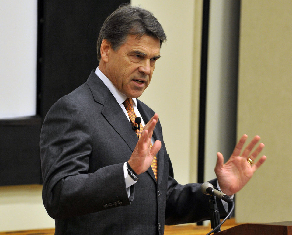 Photo - Texas Gov. Rick Perry speaks on civility in politics at the Ferguson Library in Stamford, Conn. on Monday, June 17, 2013. Perry and South Dakota Gov. Dennis Daugaard visited Connecticut on Monday to court gun manufacturers that have threatened to leave since the state passed tough new gun-control laws this year in response to the massacre at Sandy Hook Elementary School. (AP Photo/The Stamford Advocate, Jason Rearick)