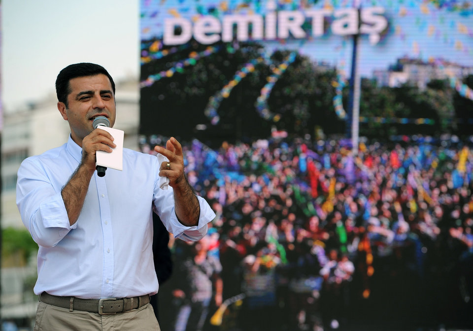 Photo - Selahattin Demirtas, the Turkish Kurdish presidential candidate, gestures, as he addresses a rally in Izmir, Turkey, Saturday, Aug. 9, 2014. An ambitious young Kurdish politician, Demirtas heads the left-wing People's Democratic Party. A lawyer by trade, he became involved in human rights groups in Turkey's Kurdish region and began his political career in 2007. He has focused his campaign on championing the cause of the oppressed, the poor, the young and the working classes.  Some 53 million Turks go the polls on Sunday to choose their 12th president in an election considered a turning point for the country of 76 million people, with Prime Minister Recep Tayyip Erdogan vying for the position he has pledged to transform from a symbolic role into a position of power. (AP Photo/Emre Tazegul)