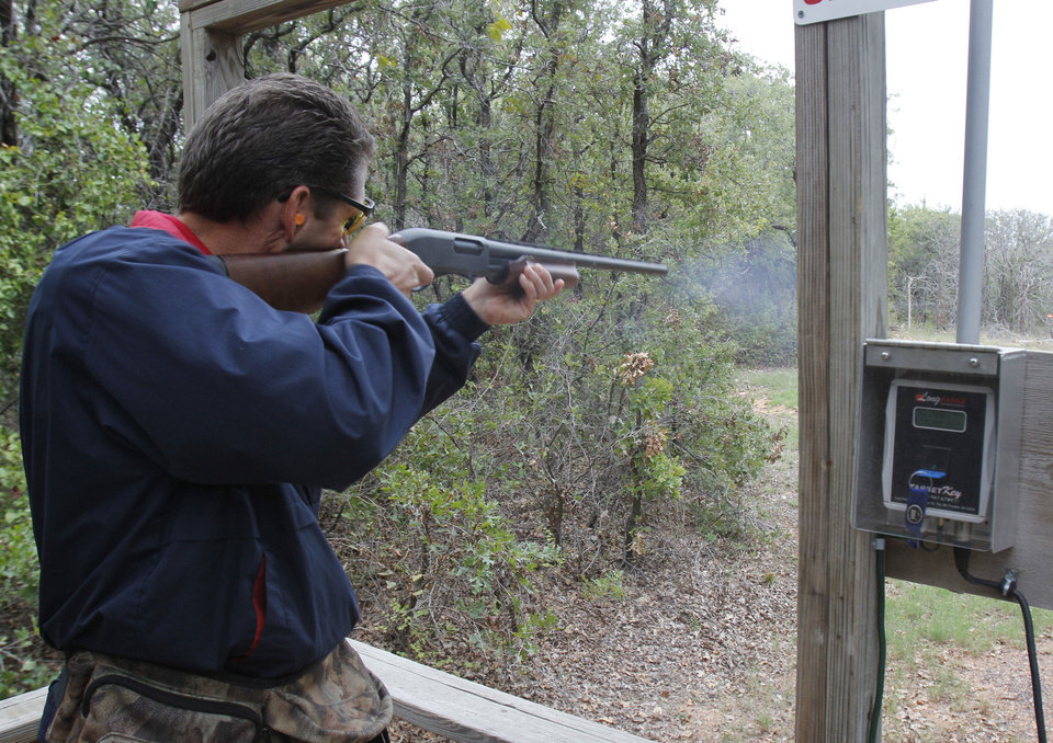 Trevor Thomson was one of the participants in the Edmond Area Chamber of Commerce's annual sporting clays tournament. He is taking one of his shots. PHOTO BY PAUL HELLSTERN, THE OKLAHOMAN. <strong>PAUL HELLSTERN - OKLAHOMAN</strong>