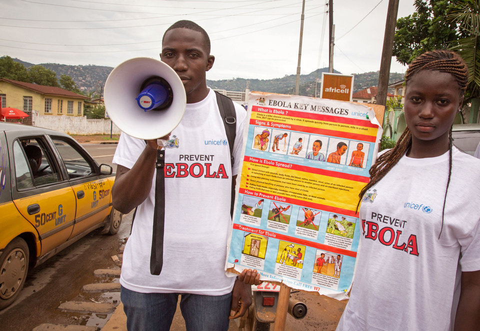 Photo - A man and woman taking part in a Ebola prevention campaign holds a placard with an Ebola prevention information message in the city of Freetown, Sierra Leone, Wednesday,  Aug. 6, 2014.  The World Health Organization has begun an emergency meeting on the Ebola crisis, and said at least 932 deaths in four African countries are blamed on the virus, with many hundreds more being treated in quarantine conditions. (AP Photo/ Michael Duff)
