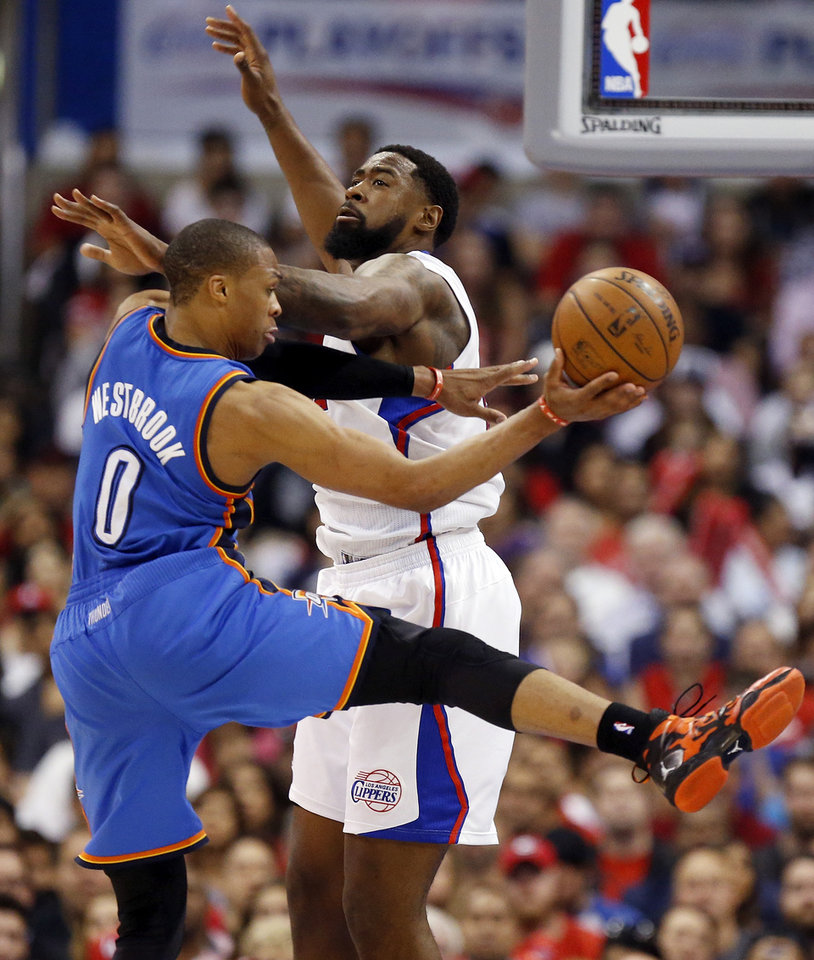 Oklahoma City's Russell Westbrook (0) passes around Los Angeles' DeAndre Jordan (6) during Game 4 of the Western Conference semifinals in the NBA playoffs between the Oklahoma City Thunder and the Los Angeles Clippers at the Staples Center in Los Angeles, Sunday, May 11, 2014. Photo by Nate Billings, The Oklahoman