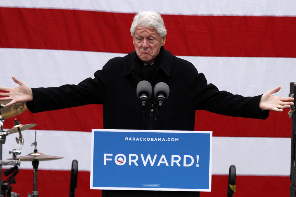 Former President Bill Clinton gestures as he speaks at a rally to get out the vote for President Barack Obama in downtown Pittsburgh, Monday, Nov. 5, 2012. (AP Photo/Gene J. Puskar)