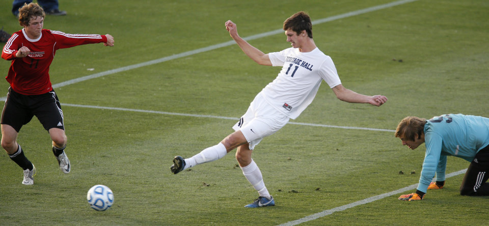 Photo - Heritage Hall's Connor McGinnis scores a goal between Skiatook's Bryce Shook, left, and RJ Brough during the Class 5A boys soccer championship between Heritage Hall and Skiatook in Norman, Okla., Friday, May 16, 2014. Photo by Bryan Terry, The Oklahoman