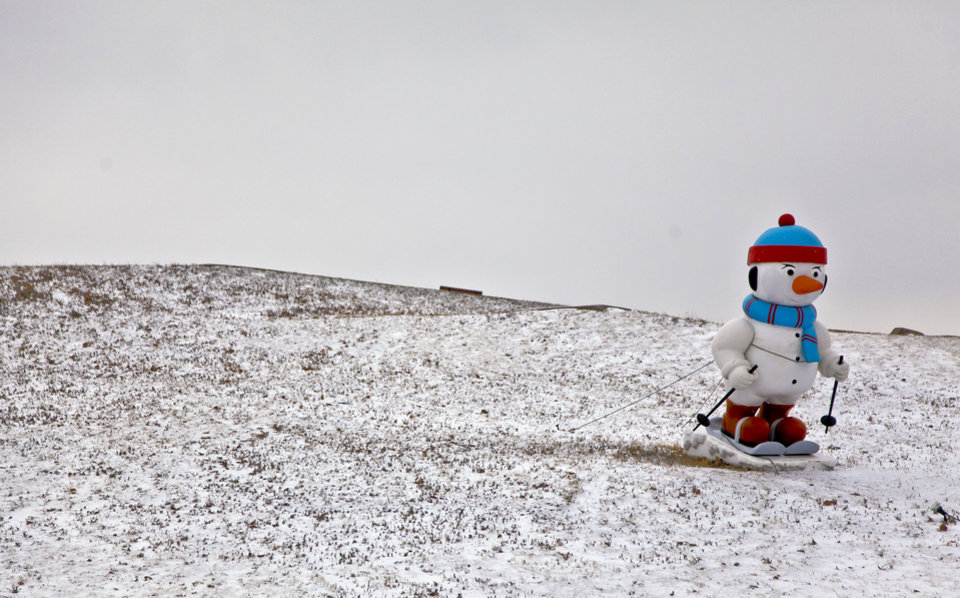 COLD / WINTER WEATHER / SNOW: A snowman decoration takes to the slopes at Chisholm Trail Park on Friday, Dec. 28, 2012, in Yukon, Okla.  Photo by Chris Landsberger, The Oklahoman