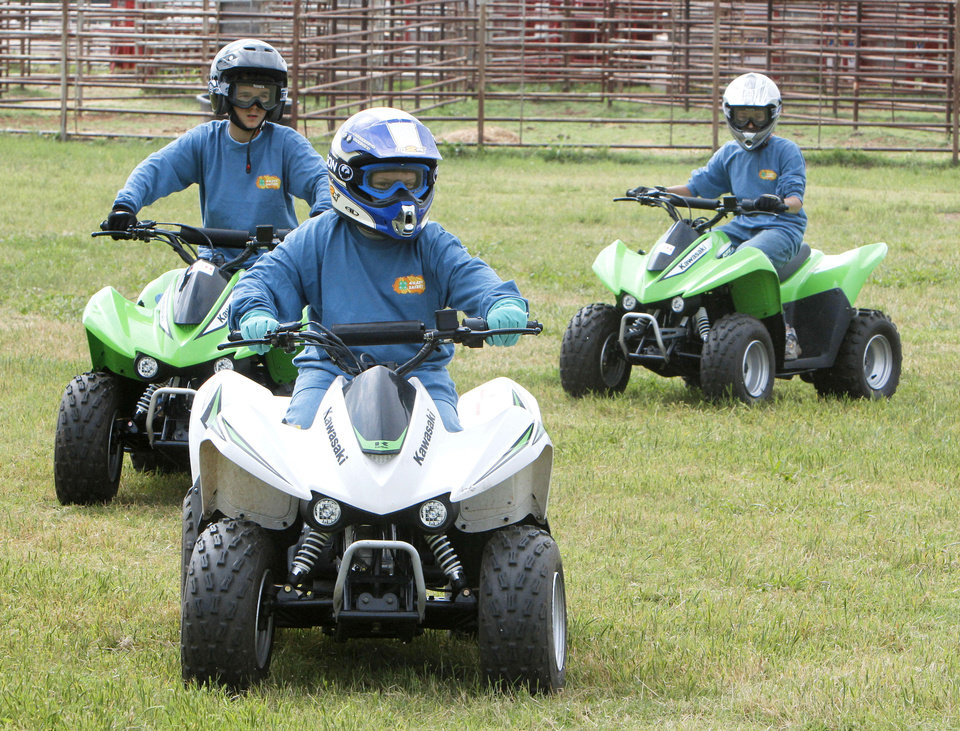 Jared Welch maneuvers during a 2012 children�s ATV safety course at the Logan County Fairgounds. Photo By Paul Hellstern, The Oklahoman Archives