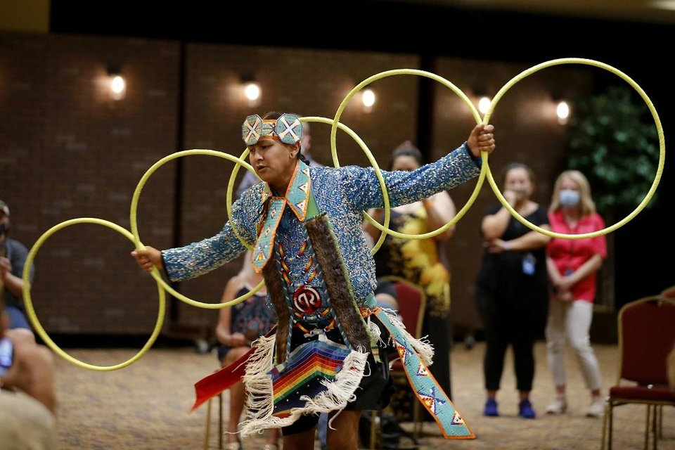 Photo - Jace Roberts, who is Choctaw and Nakoda, performs a hoop dance during a dance exhibition by the Central Plains Dancers at the Red Earth Festival at Grand Event Center at the Grand Casino Hotel & Resort, Saturday, Sept. 5, 2020. [Bryan Terry/The Oklahoman]