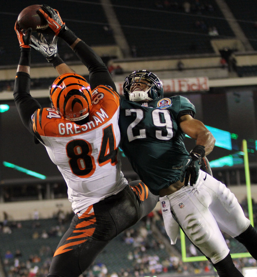 Photo - Bengals tight end Jermaine Gresham goes up for the ball as Eagles safety Nate Allen tries to prevent the catch. Philadelphia Eagles fell to the Cincinnati Bengals 34-13 at Lincoln Financial Field Thursday, Dec. 13, 2012. (AP Photo/The News Journal, Daniel Sato)