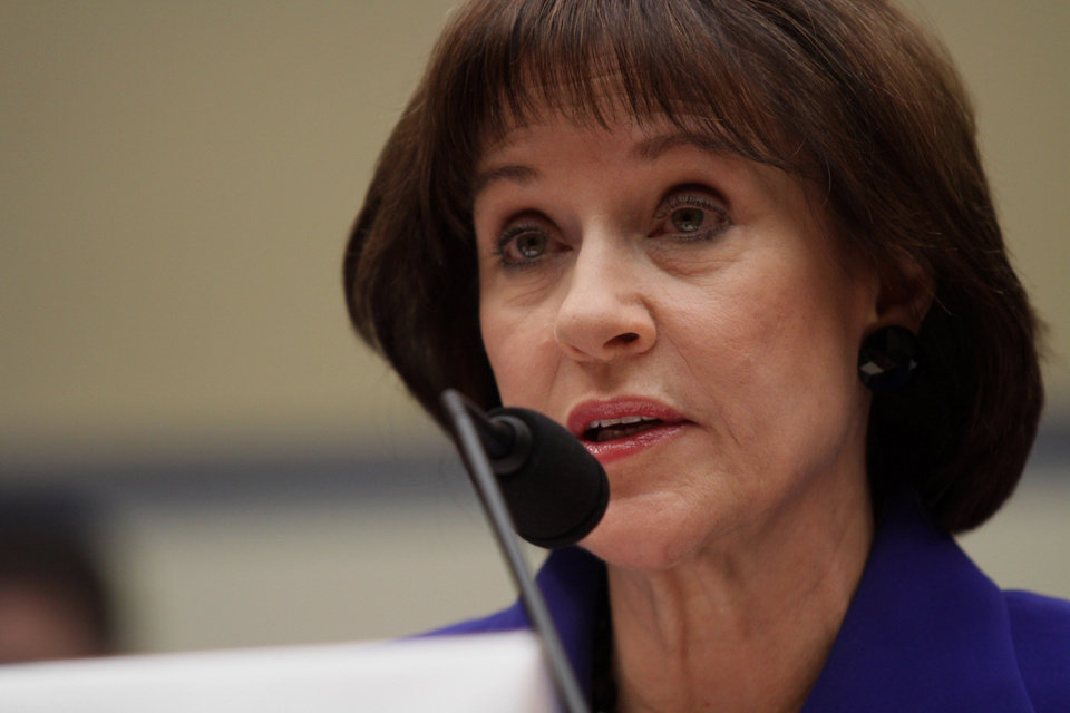Photo - FILE - In this March 5, 2014, file photo, former Internal Revenue Service (IRS) official Lois Lerner speaks on Capitol Hill in Washington. The Justice Department is investigating the circumstances behind the disappearance of emails from Lerner, part of a broader criminal inquiry into whether the agency had targeted conservative groups seeking tax-exempt status, according to congressional testimony released Wednesday. (AP Photo/Lauren Victoria Burke, File)