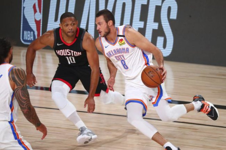Photo -  Thunder forward Danilo Gallinari (8) drives against Rockets guard Eric Gordon (10) during the first half of Game 4. [Kim Klement/USA Today Sports]