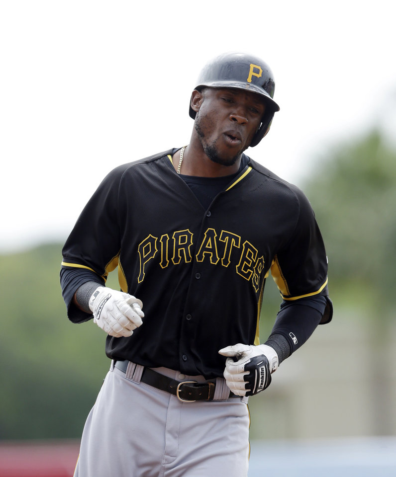 Photo - Pittsburgh Pirates' Starling Marte rounds third base after his solo home run during the first inning of a spring exhibition baseball game against the Baltimore Orioles in Sarasota, Fla., Sunday, March 23, 2014. (AP Photo/Carlos Osorio)