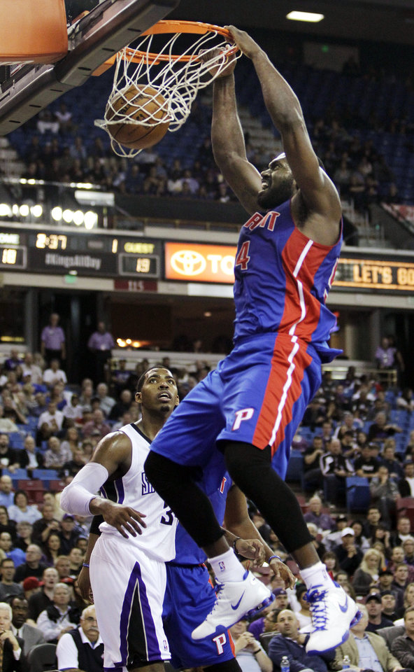 Detroit Pistons forward Jason Maxiell, right, dunks over Sacramento Kings forward Jason Thompson during the first quarter of an NBA basketball game in Sacramento, Calif., Wednesday, Nov. 7, 2012. (AP Photo/Rich Pedroncelli)