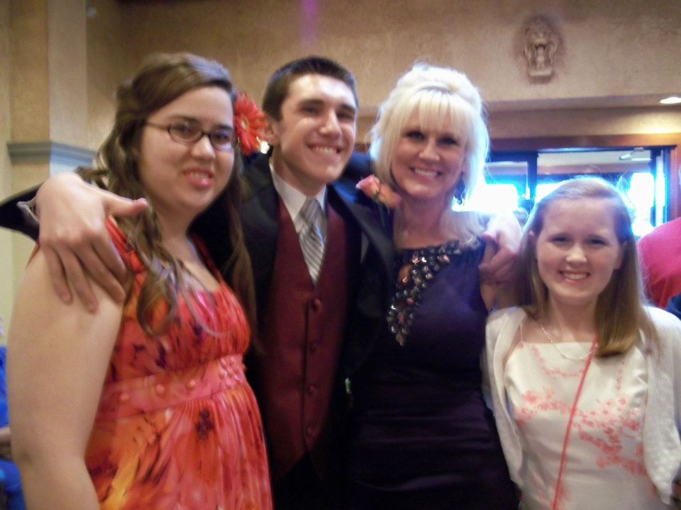 Special-education students who attended an Edmond prom last year included Kolby Gill, Logan Doughty, adult chaperone Lori Abel and Rebecca Klemp.  Photo provided by Edmond Public Schools