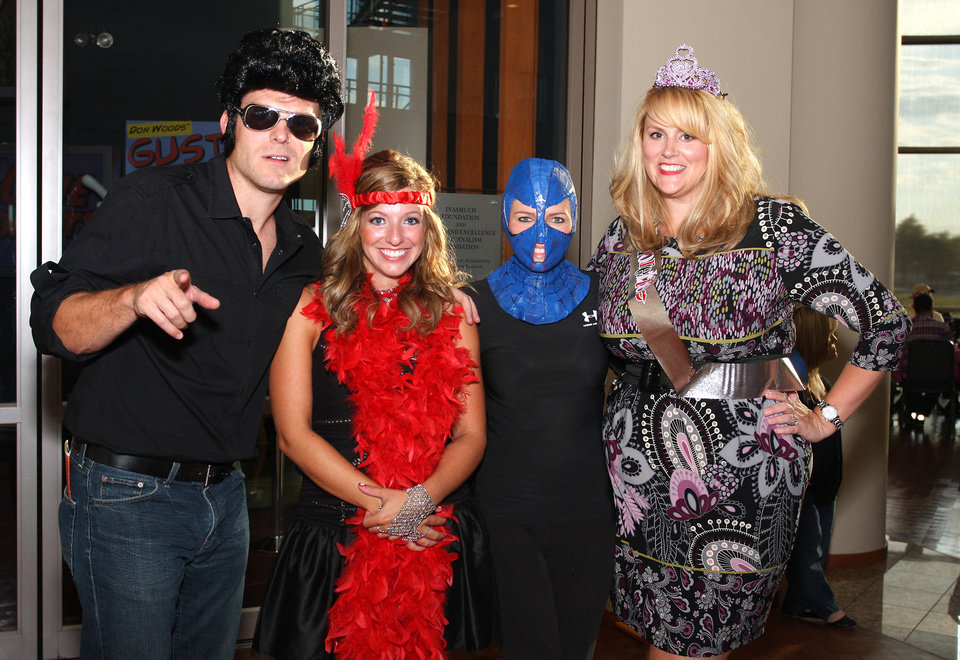 Photo -  Zach and Carrie Hall, Jennifer Fritsch and Jamie Manoles get with the mood at the Trivia party.