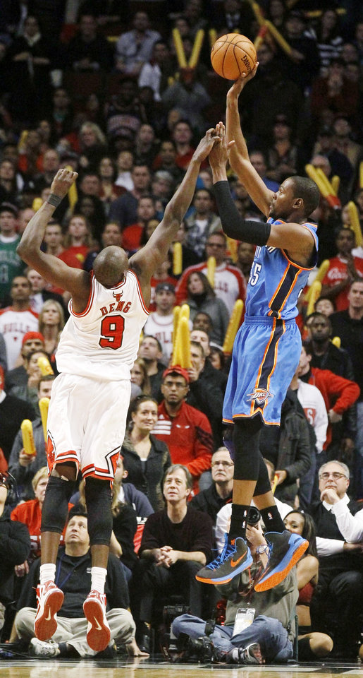 Oklahoma City Thunder forward Kevin Durant, right, shoots over Chicago Bulls forward Luol Deng during the second half of an NBA basketball game, Thursday, Nov. 8, 2012, in Chicago. The Thunder won 97-91. (AP Photo/Charles Rex Arbogast) ORG XMIT: CXA112