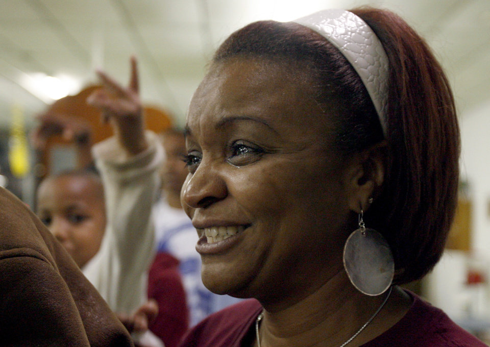 Photo - Stacey Wilson, of Spencer, reacts after Barack Obama was elected the nation's first black president at the Images of Hair and Nails  salon Tuesday, Nov. .4, 2008, in Oklahoma City. PHOTO BY SARAH PHIPPS, THE OKLAHOMAN.