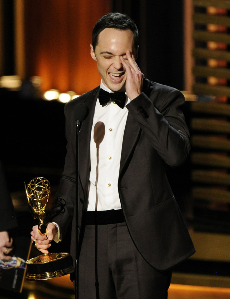 "Photo - Jim Parsons accepts the award for outstanding lead actor in a comedy series for his work on ""The Big Bang Theory"" at the 66th Annual Primetime Emmy Awards at the Nokia Theatre L.A. Live on Monday, Aug. 25, 2014, in Los Angeles. (Photo by Chris Pizzello/Invision/AP)"