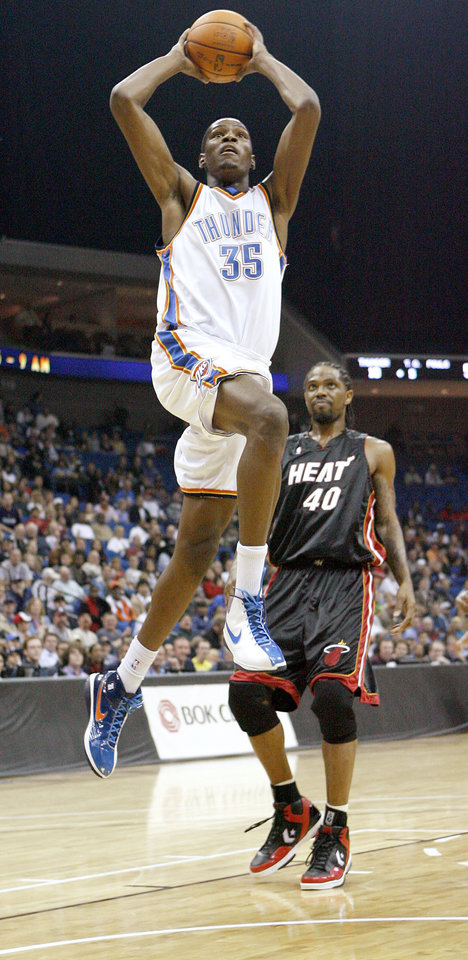 Oklahoma City's Kevin Durant goes to the basket in front of Miami's Udonis Haslem during an NBA preseason game between the Oklahoma City Thunder and the Miami Heat at the BOK Center in Tulsa, Okla., Wednesday, October 14, 2009. Photo by Bryan Terry, The Oklahoman