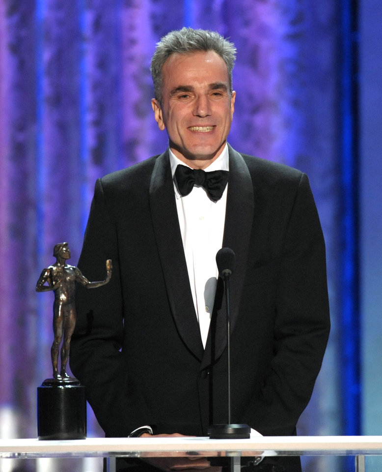 "Photo - Daniel Day-Lewis accepts the awards for outstanding male actor in a leading role for ""Lincoln"" at the 19th Annual Screen Actors Guild Awards at the Shrine Auditorium in Los Angeles on Sunday Jan. 27, 2013. (Photo by John Shearer/Invision/AP)"