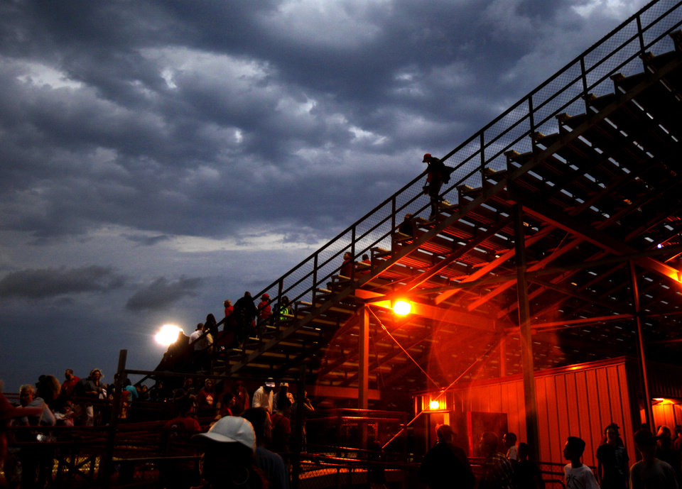 Fans leave the Carl Albert stadium during a weather delay in a high school football game between Carl Albert and Coweta at Carl Albert in Midwest City, Friday, September 7, 2012. Photo by Bryan Terry, The Oklahoman
