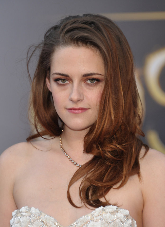 Photo - Actress Kristen Stewart arrives at the Oscars at the Dolby Theatre on Sunday Feb. 24, 2013, in Los Angeles. (Photo by John Shearer/Invision/AP)
