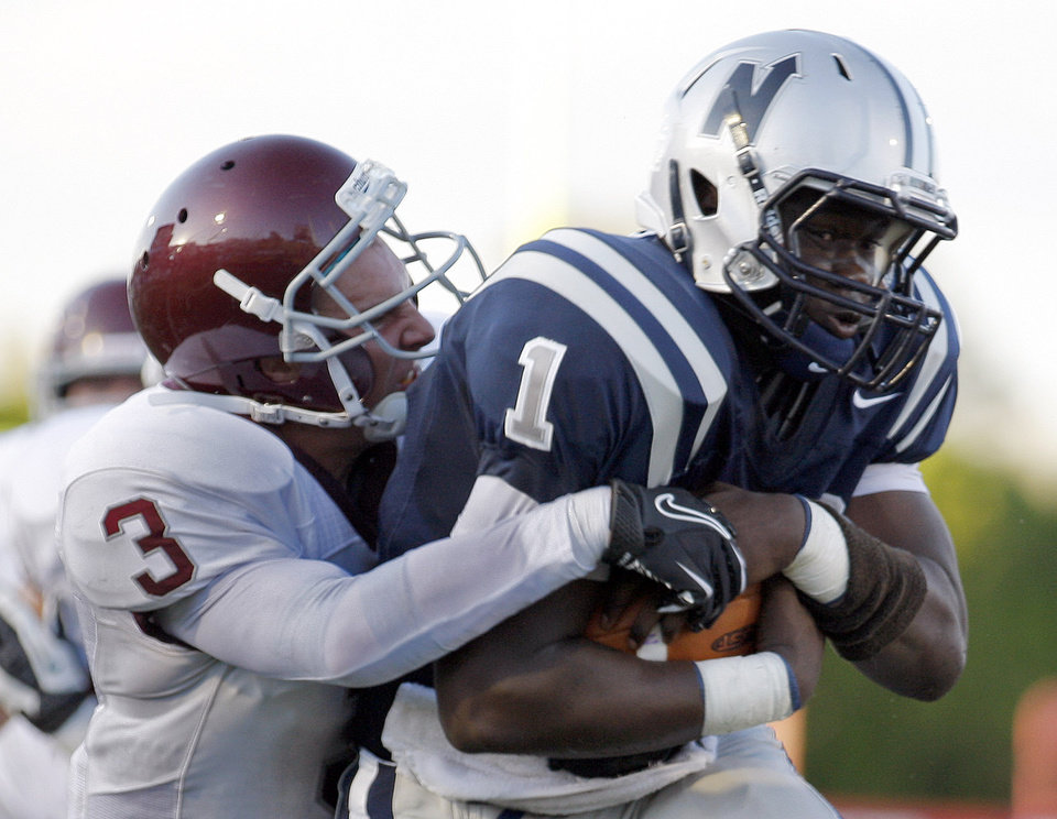 Photo - Edmond North's Michael Farmer tries to get by Edmond Memorial's Sam Kreutzer during the high school football game between Edmond North and Edmond Memorial at Wantland Stadium in Edmond, Okla., Friday, Aug. 31, 2012. Photo by Sarah Phipps, The Oklahoman
