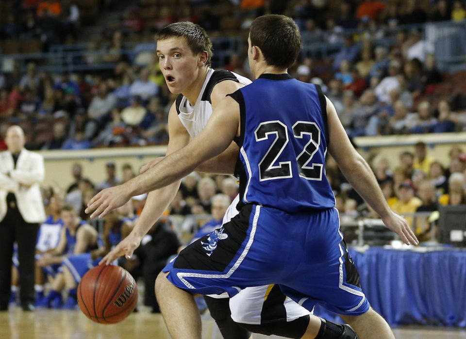 Photo - Arnett's Tyler Tune goes around Coyle's Ryan Weathers during the Class B boys state championship game between Coyle and Arnett in the State Fair Arena at State Fair Park in Oklahoma City, Saturday, March 2, 2013. Photo by Bryan Terry, The Oklahoman