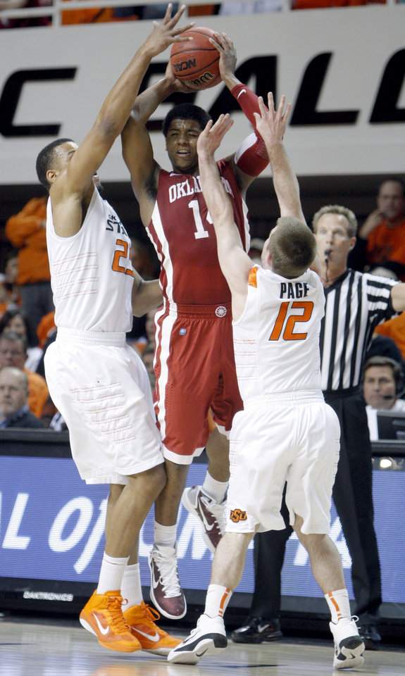 Photo - Oklahoma State's Markel Brown (22) and Oklahoma State's Keiton Page (12)Êpressure Oklahoma's Carl Blair Jr. (14) during the Bedlam men's college basketball game between the University of Oklahoma Sooners and Oklahoma State University Cowboys at Gallagher-Iba Arena in Stillwater, Okla., Saturday, February, 5, 2011. Photo by Sarah Phipps, The Oklahoman