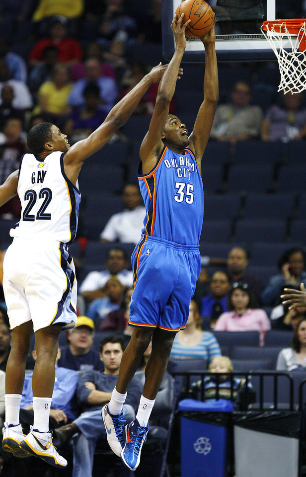 Photo - Memphis Grizzlies forward Rudy Gay (22) tries to block a dunk by Oklahoma City Thunder's Kevin Durant (35) during the first half of a preseason NBA basketball game Wednesday, Oct. 7, 2009, in Memphis, Tenn. (AP Photo/Lance Murphey) ORG XMIT: TNLM103