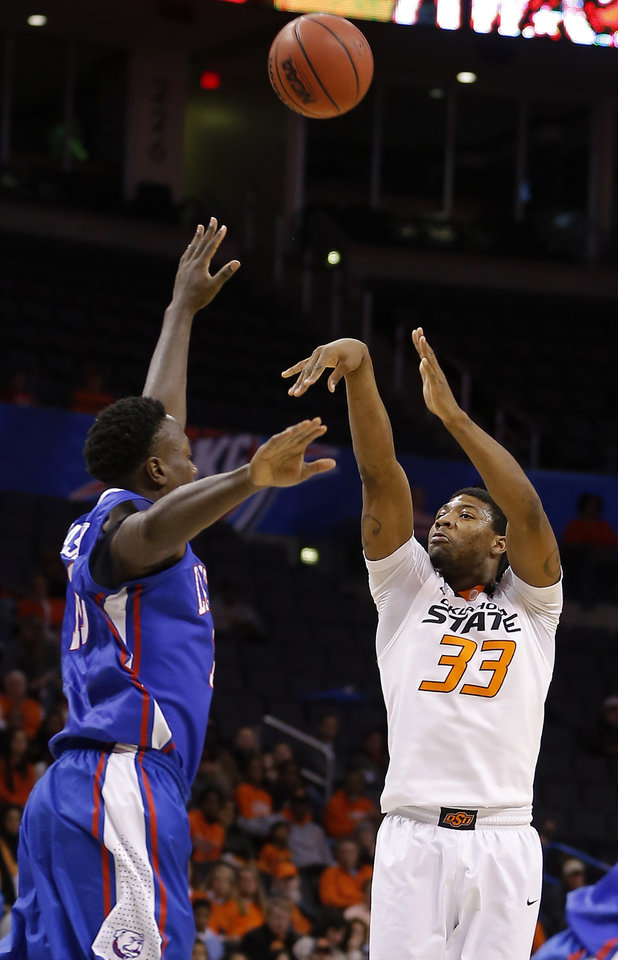 Photo - Oklahoma State's Marcus Smart (33) shoots over Louisiana Tech's Isaiah Massey (10) during the All-College Classic basketball game between Oklahoma State University and Louisiana Tech at Chesapeake Energy Arena in Oklahoma City, Okla., Saturday, Dec. 14, 2013. Photo by Bryan Terry, The Oklahoman