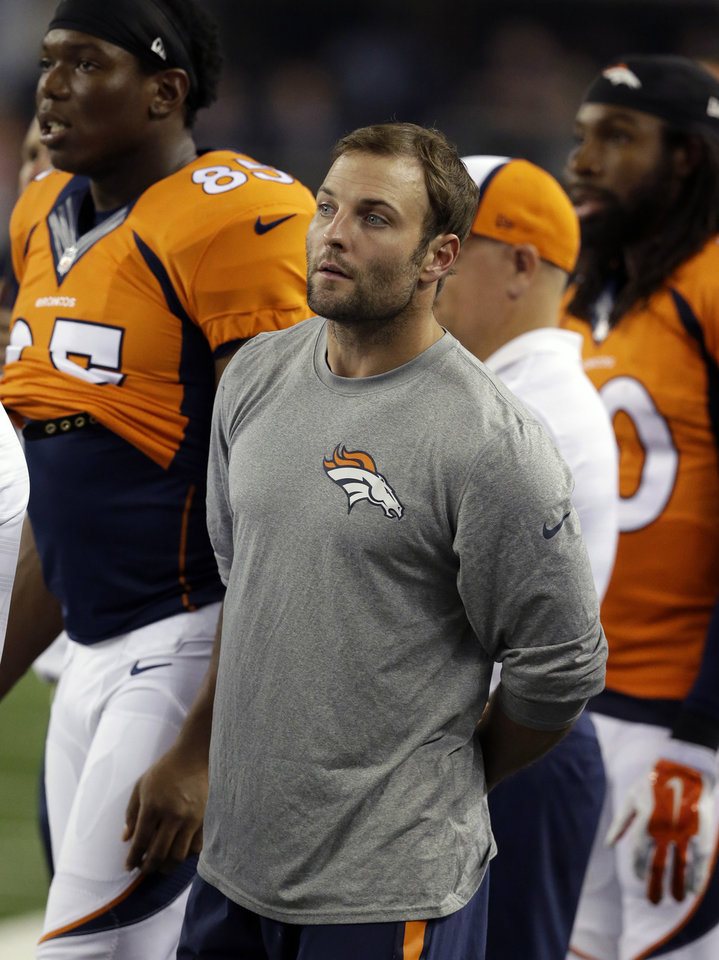 Denver Broncos wide receiver Wes Welker and Virgil Green, left rear, watch play from the sideline against the Dallas Cowboys in the second half of a NFL preseason football game, Thursday, Aug. 28. 2014, in Arlington, Texas. LM Otero - AP
