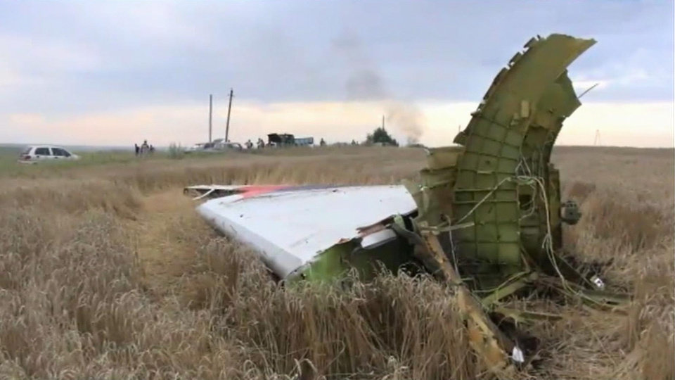Photo - In this image taken from video, Thursday July 17, 2014,  showing part of the wreckage of a passenger plane carrying 295 people was shot down Thursday as it flew over the country and plumes of black smoke rose up near a rebel-held village Hrabove, in eastern Ukraine. Malaysia Airlines tweeted that it lost contact with one of its flights as it was traveling from Amsterdam to Kuala Lumpur over Ukrainian airspace. (AP Photo / Channel 1) RUSSIA OUT - TV OUT