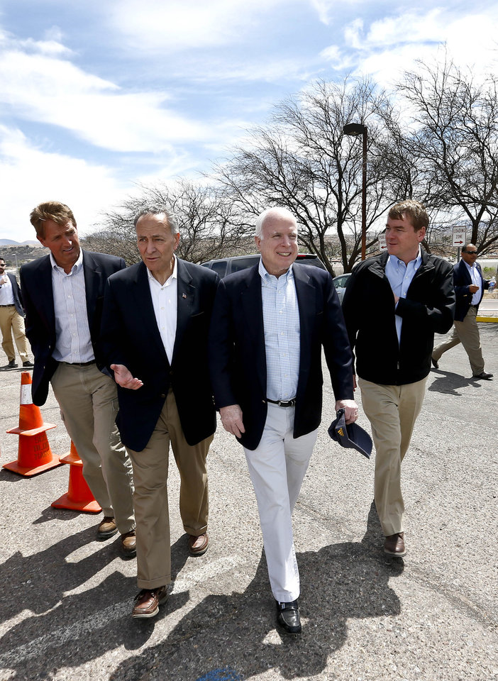 Photo - From left, Sen. Jeff Flake, R-Ariz., Sen. Chuck Schumer, D-NY, Sen. John McCain, R-Ariz., and Sen. Michael Bennett, D-Colo, arrive at a news conference after their tour of the Mexico border with the United States on Wednesday, March 27, 2013, in Nogales, Ariz.  The senators are part of a larger group of legislators shaping and negotiating details of an immigration reform package vowed Wednesday to make the legislation public when Congress reconvenes next month. (AP Photo/Ross D. Franklin)