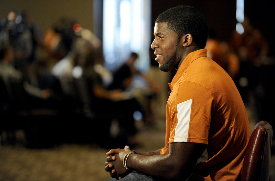 Photo - Texas linebacker Emmanuel Acho answers questions during NCAA college football Big 12 Media Days, Monday, July 25, 2011, in Dallas. (AP Photo/Matt Strasen)